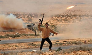 A Libyan rebel fighter during a battle on the road between Ras Lanuf and Bin Jawad