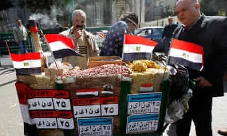 A vendor sells pulp and peanuts near Tahrir Square