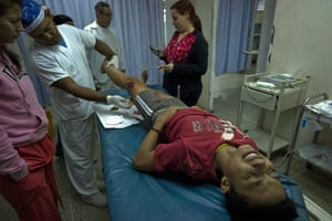 Venezuela Caracas : A fifteen year old boy receiving treatment to ashotgun wound Petare Caracas