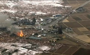 Japan earthquake: Houses are washed away by tsunami in Sendai, Japan