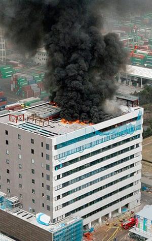 Japan earthquake: An office building burns in Tokyo, Japan
