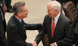 Robert Gates greets German counterpart Thomas de Maiziere at meeting over Afghan troop withdrawal