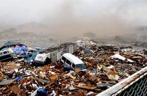 Japanese Earthquake: Cars swept away by tsunami tidal waves, Kesennuma, Miyagi Prefecture