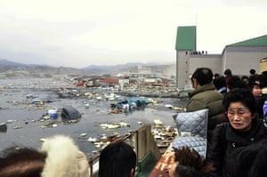 Japanese Earthquake: People watch the aftermath of tsunami at port, Kesennuma, Miyagi Prefecture