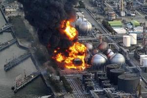Japanese Earthquake: Gas storage tanks burn at Cosmo oil refinery, Ichihara, Chiba Prefecture