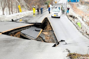 Japanese Earthquake: Japanese police on a destroyed highway, Fukushima prefecture