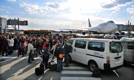 Passengers evacuate from the terminal bu