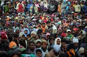 Ras Jdir Refugees: Men from Bangladesh wait patiently for information in Ras Jdir camp