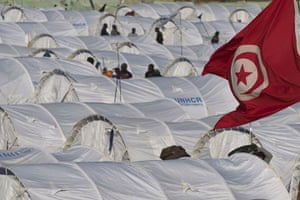 Ras Jdir Refugees: A Tunisian flag flies above tents in the Choucha refugee camp