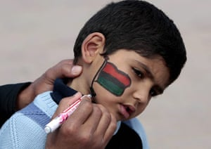 Benghazi Protests: A protester paints a Libyan flag on his sons face