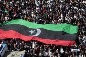 Benghazi Protests: Anti-Gadhafi protesters wave a huge pre-Gadhafi Libyan flag