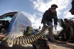 Benghazi Protests: A Libyan rebel fighter mans an anti-aircraft machinegun