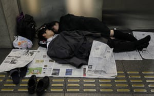 Japanese Earthquake: Stranded people rest at the Tokyo International Forum