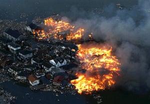 Japanese Earthquake: Houses ablaze in Natori city in Miyagi prefecture