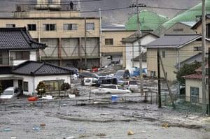Japanese Earthquake: A tsunami tidal wave smashes vehicles and houses at Kesennuma city