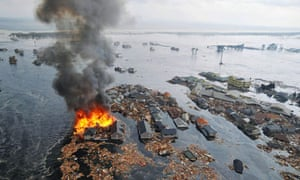 houses burn in tsunami waves japan