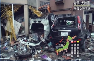 Japan Tsunami: Badly damaged vehicles are seen on Japan's NHK TV in Iwate Prefecture
