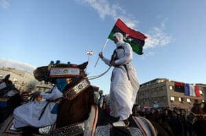 24 Hours in Pictures: A Libyan rebel on horseback