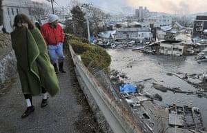 Japan - the day after: Residents walk in Kesen Numa
