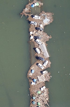 Japan - the day after: Vehicles in flood waters