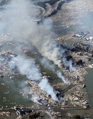 Japan - the day after: Smoke rises from houses