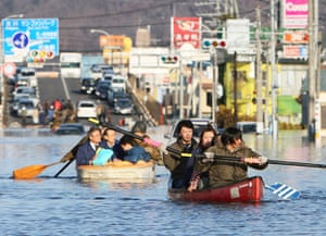 Japan - the day after: People evacuate in small boats