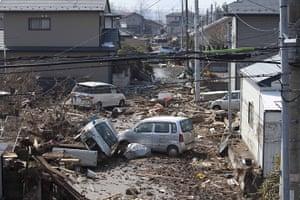 Dan Chung in Japan: Cars amongst the debris following the tsunami which hit in Shintona, Japan