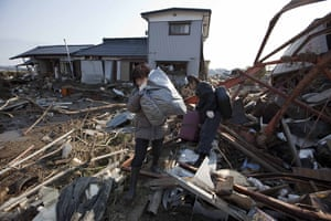 Dan Chung in Japan: Locals salvage belongings from tsunami and earthquake damaged buildings