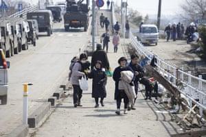 dan chung in Shintona: Survivors walk over a bridge