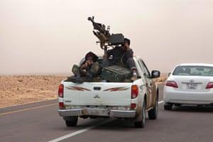 sean smith in libya: Rebel militia withdraw from the area around Brega