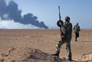sean smith in libya: Rebel fighters attempt to spot a jet flying overhead in Ras Lanuf