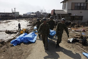 Dan Chung in Japan: Rescue workers recover bodies