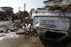 Dan Chung in Japan: An overturned vehicle in the debris