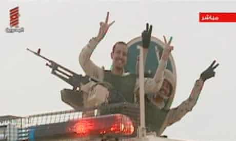 Saudi Arabian troops as they cross the causeway leading to Bahrain
