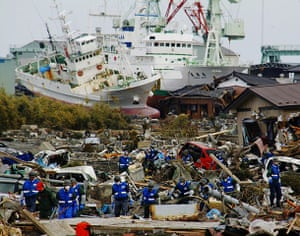 Japan rescue work: Japan Ground Self-Defence Force members search for the victims in Miyako