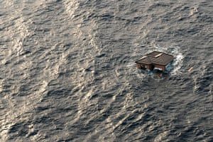 Japan rescue work: A house adrift in the Pacific Ocean in the coastal waters near Sendai