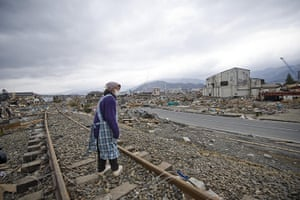 Japan rescue work: A resident looks at the ruins of Ofunato city, Iwate Prefecture