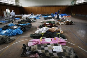 Japan rescue work: Bodies found in Otsuchi are collected in a sports hall