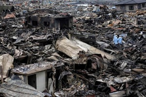 Japan rescue work: Rescue workers search through ruins of devastated Otsuchi