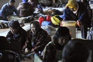 Japan rescue work: Survivors stay at a makeshift evacuation centre in Kesennuma
