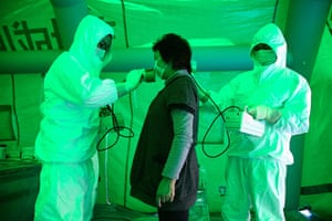 japan disatster: woman checked for radiation exposure in Hitachi