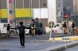 Bahrain uprising: A protester stands in front of the military in Pearl Square