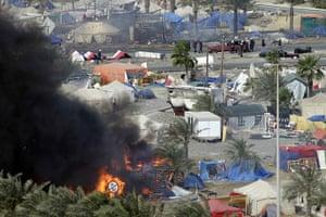 Bahrain uprising: Tents burn in Pearl Square