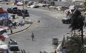 Bahrain uprising: A Gulf Cooperation Council (GCC) soldier walks through Pearl Square