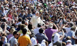 Pope Benedict XVI is driven through the crowd in St Peter's Square, Vatican City