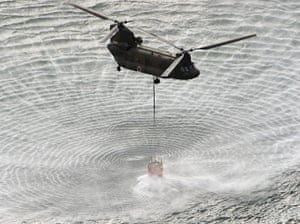 Japan aftermath: Helicopter scoops sea water for Fukushima power plant