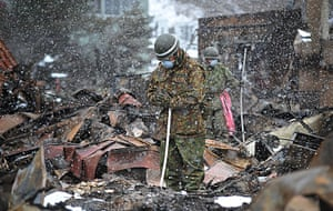 Japan aftermath: A Japanese soldier prays