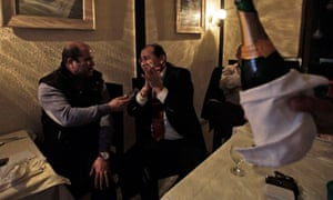 Libyans who work in Tunisia are served with champagne to celebrate the UN resolution