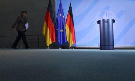 Angela Merkel arrives for a press conference in Berlin