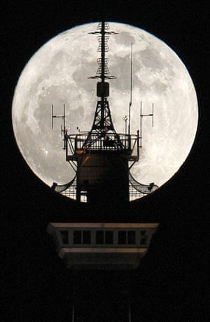 Super moon: Berlin, Germany: Behind the top of the Funkturm radio and television tower